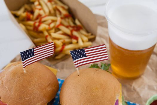Close-up of snacks and drink decorated with 4th july theme