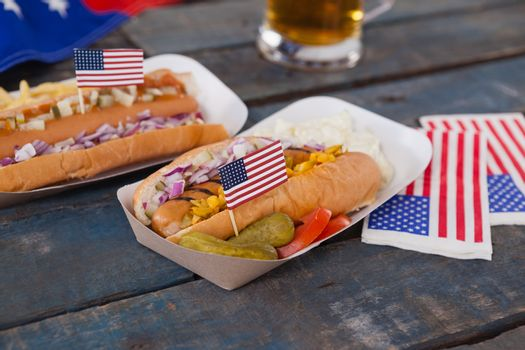 Hot dogs decorated with 4th july theme on wooden table
