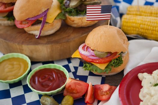 Hamburger decorated with 4th july theme on table