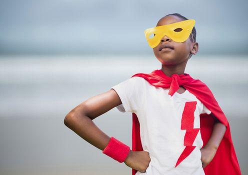 Girl superhero against blurry beach