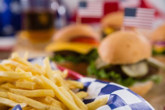 Close-up of french fries in basket with 4th july theme