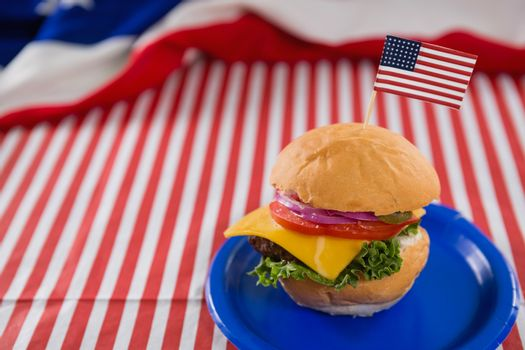 Close-up of burger decorated with 4th july theme