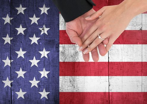 Digital composite of Couple with hands together  against american flag
