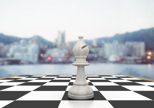 Chess piece against blurry skyline