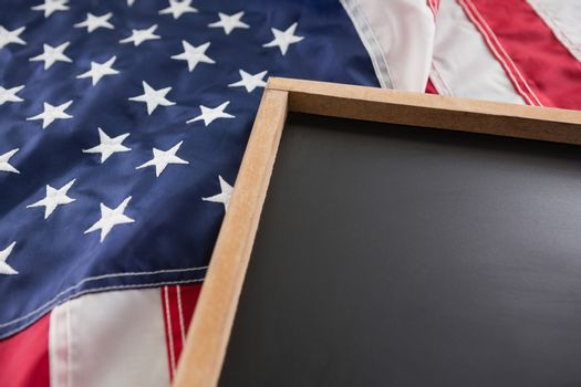 Close-up of American flag and slate