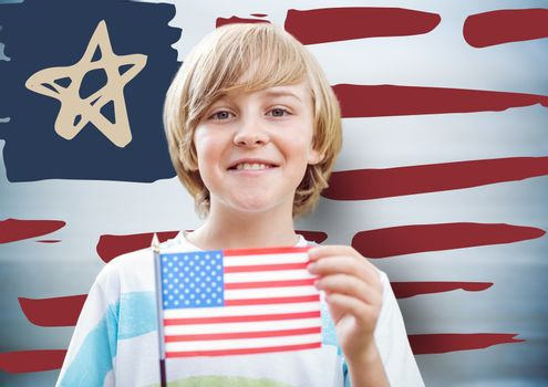 Boy holding american flag against hand drawn american flag and blurry blue background