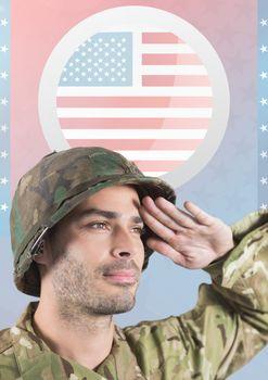 American soldier saluting  against american flag