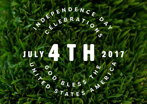 White fourth of July graphic against grass