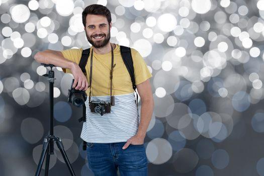 Smiling cameraman on a spotlight background