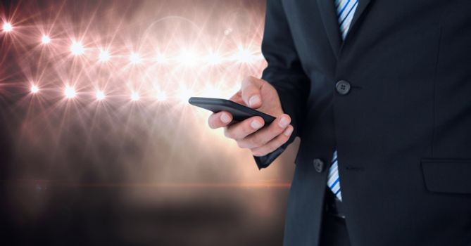 Part of a businessman texting