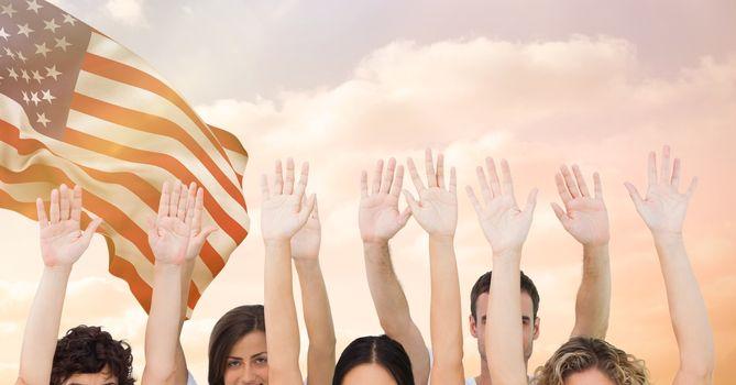 Hands up against fluttering american flag background