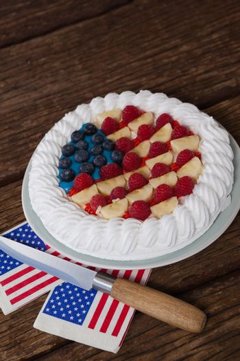 Fruitcake with 4th july theme on wooden table