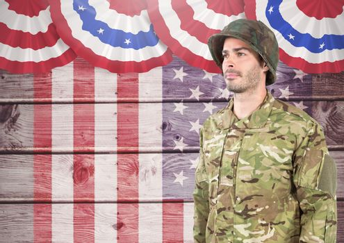 Soldier standing against american flag background