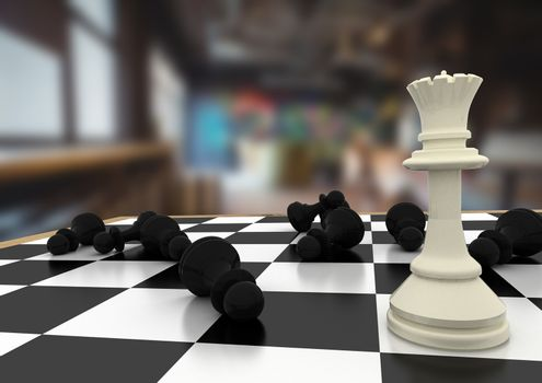 Chess pieces against blurry room