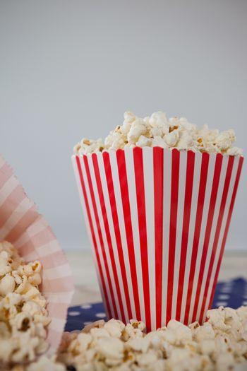 Scattered popcorn against white background with 4th july theme