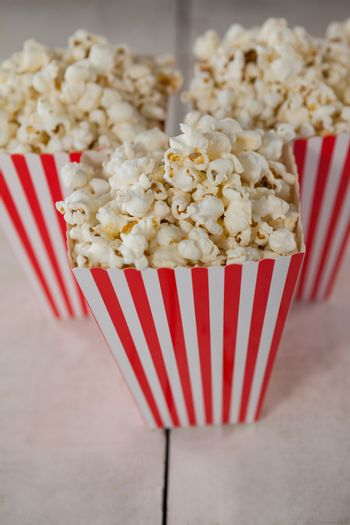 Popcorn arranged on wooden table with 4th july theme