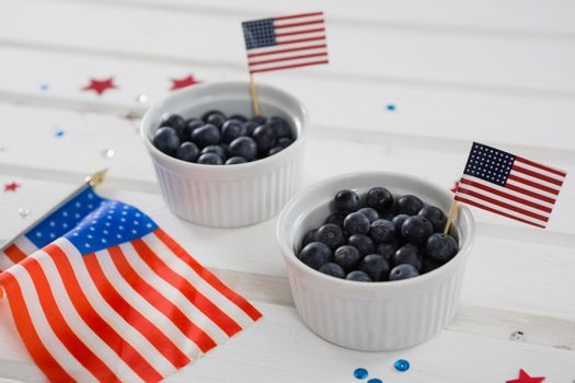 Black berries decorated with 4th july theme on wooden table