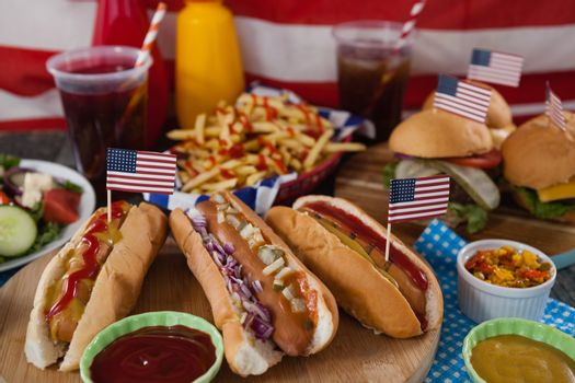 Drink and snacks on wooden table with 4th july theme