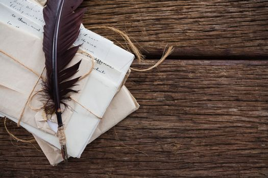 Quill feather with nostalgic letters