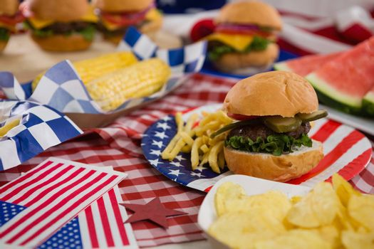 Burger and potato chips on plate with 4th July theme