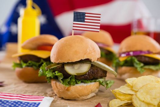 Close-up of burger decorated with 4th july theme on wooden table