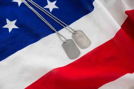Close-up of dog tag chain on an American flag