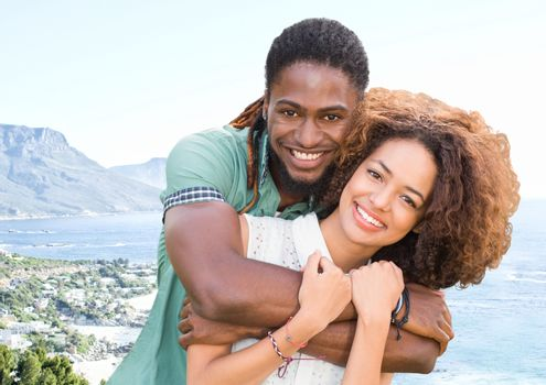 Millennial couple against blurry coastline