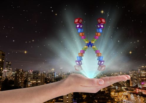 hand with application icons chromosome over and with blue lights .In front of blurred city at night