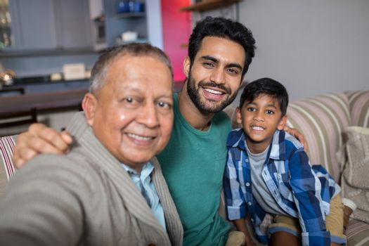 Close up of smiling family with arm around