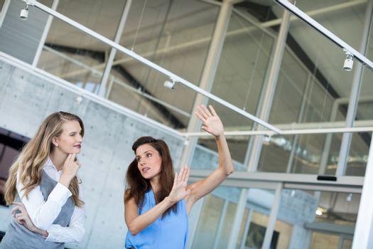 Female executives interacting with each other