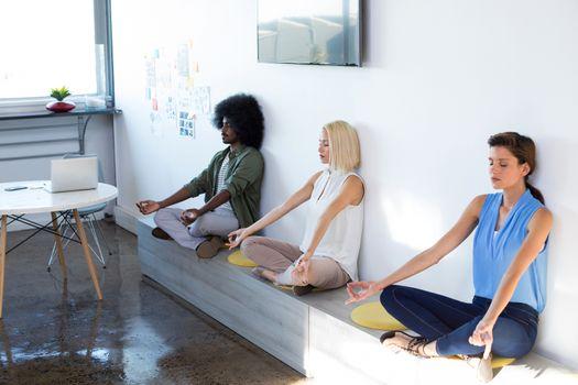 Executives doing yoga