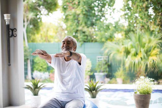 Senior man exercising in yard