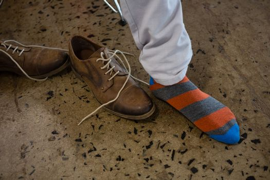 Low section of man wearing sock