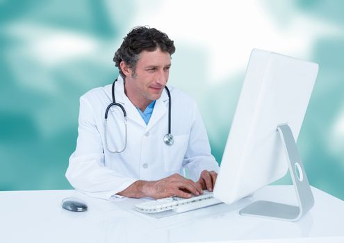 Doctor at computer against blurry teal vector mesh