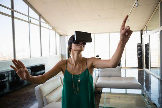 Woman using virtual reality simulator in office