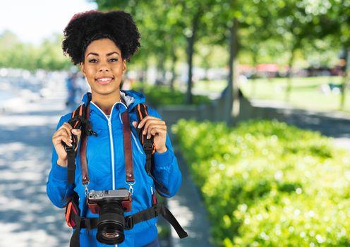 Millennial backpacker against blurry campus