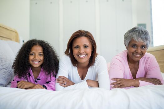 Happy family lying on bed in bed room