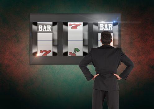 Back of Man Looking at casino slot machine