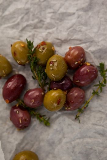 Olives with thyme on wax paper