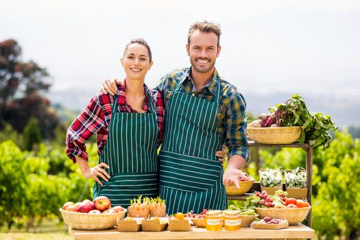 Portrait of couple selling vegetables