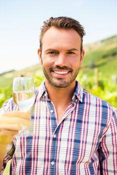 Portrait of man holding wineglass