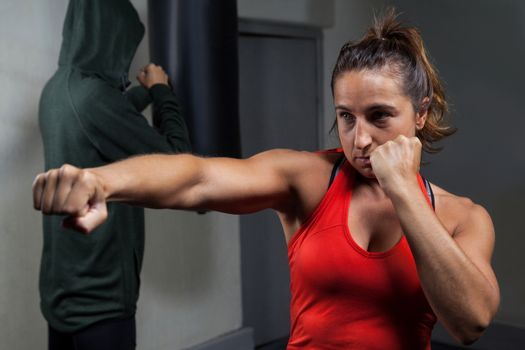 Determined women practicing boxing