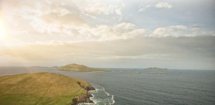 Idyllic view of landscape by sea
