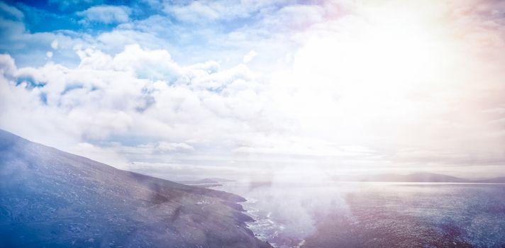 Idyllic view of mounatin by sea against sky