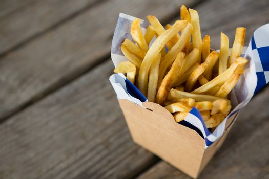 French fries with wax paper in container