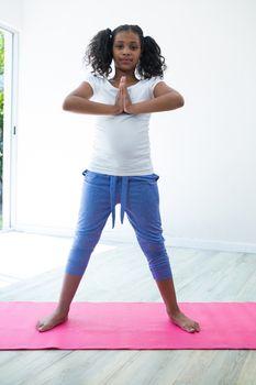 Portrait of girl in prayer position