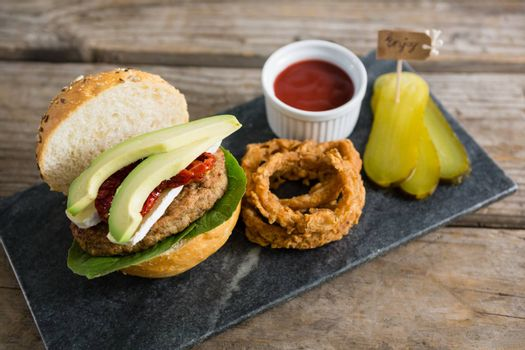 High angle view of food with burger on slate at table