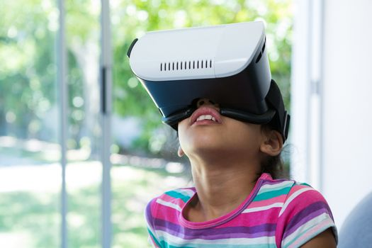 Close up of girl wearing virtual reality simulator