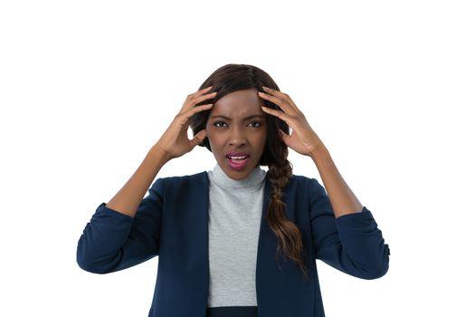 Portrait of businesswoman with head in hands