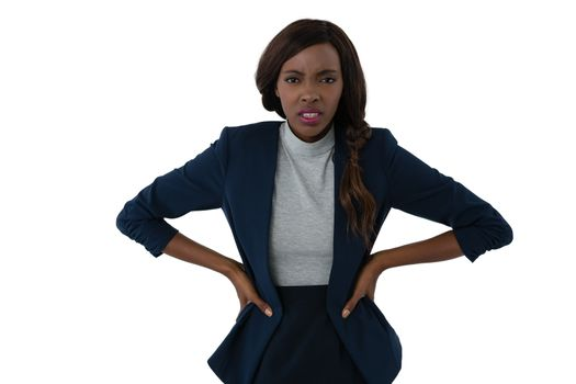 Portrait of irritated businesswoman with hands on hip